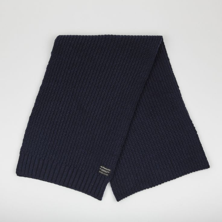 RVLT - men's fashion. Dark blue heavy wool blend scarf with knitted pattern to add detail, has til RVLT brand label.