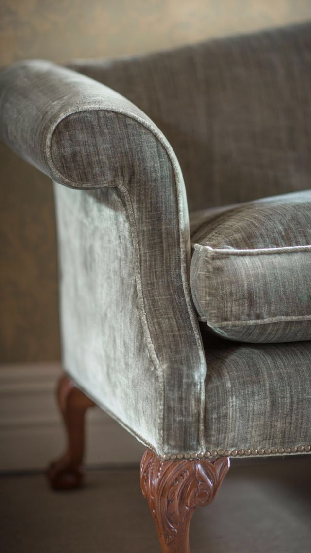 The Congreve sofa is a perfect choice for a formal drawing room. An elegant high backed sofa on carved acanthus scroll legs in the Chippendale style available in Como Silk Velvet, Moss (light green) as seen here.