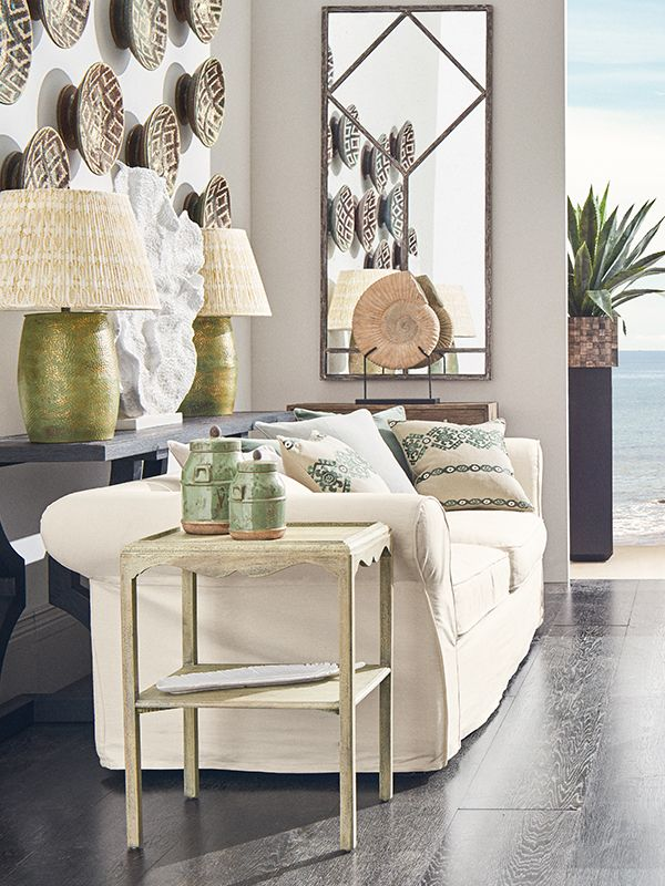 Bring the seaside to your home with a combination of neutral shades and coastal-inspired furniture and accessories from OKA.