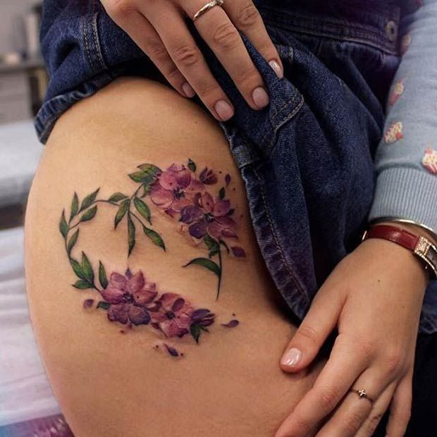Upper Side Thigh Flower Tattoo Idea for Women