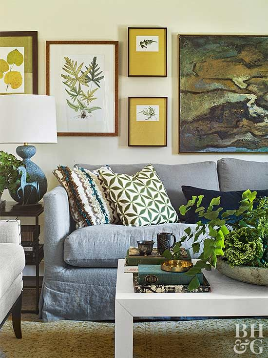 Botanical prints are the perfect pick for a gallery wall. Look for art at thrift stores and crafts shows, or consider pressing your own blooms. The key is to pick art in the same color scheme -- like this wall's leafy green and mustard hues -- then hang pieces 3-6 inches apart.