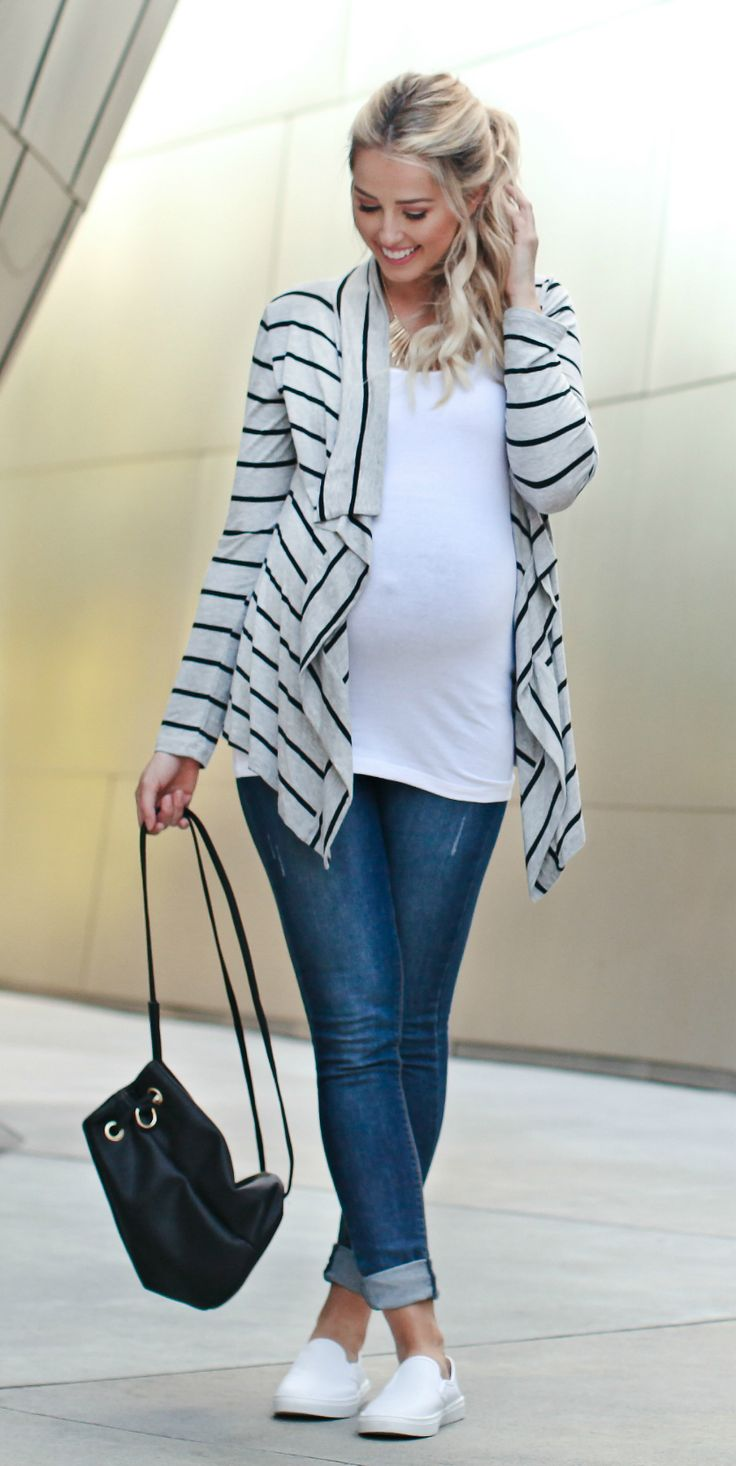 Our love for this striped maternity cardigan grows with each passing day. With a flattering free flowing front and amazingly soft material, it's easy to style this with every look come fall. Take this printed layer with you anywhere to escape the crisp air. Perfect for women's and maternity.