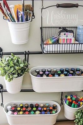 Pretty genius idea for craft room storage organization-- hang buckets on the…