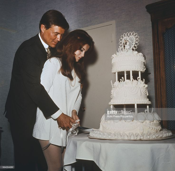 Swedish born American actress Ann-Margret and her husband, American actor Roger Smith cut their wedding cake after their wedding ceremony at the Riviera Hotel in Las Vegas, United States on 8th May 1967.