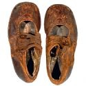 "Pair of leather children's shoes believed to be from Body No. 4, the ""Unknown Child"". This very young boy, whose body was recovered by the crew of CS Mackay-Bennett, was buried at Fairview Lawn Cemetery in Halifax, NS, Canada. Last year, DNA testing identified the boy as 19-month-old Sidney Leslie Goodwin, born in Melksham, England.  He perished that night along with his parents and siblings, Lilian Augusta, 16; Charles Edward, 14; William Frederick, 13; Jessie Allis Mary, 12; Harold Victor…"