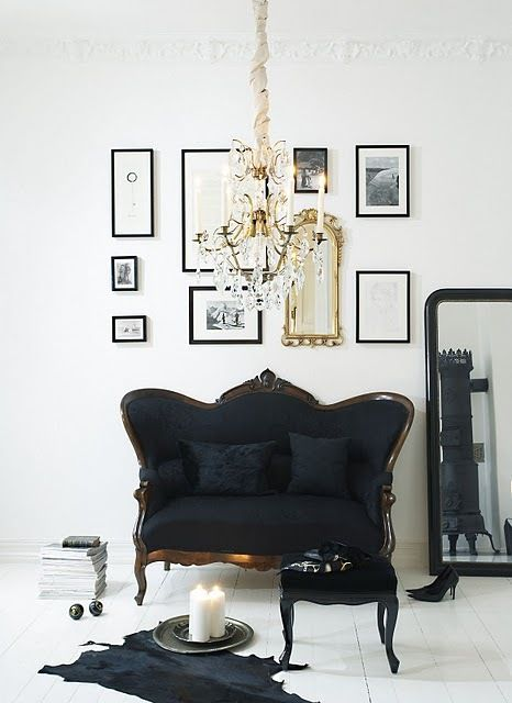 Im not usually one for black decor, but tjis is done so elegantly... black + white + gold:  I Heart Shabby Chic