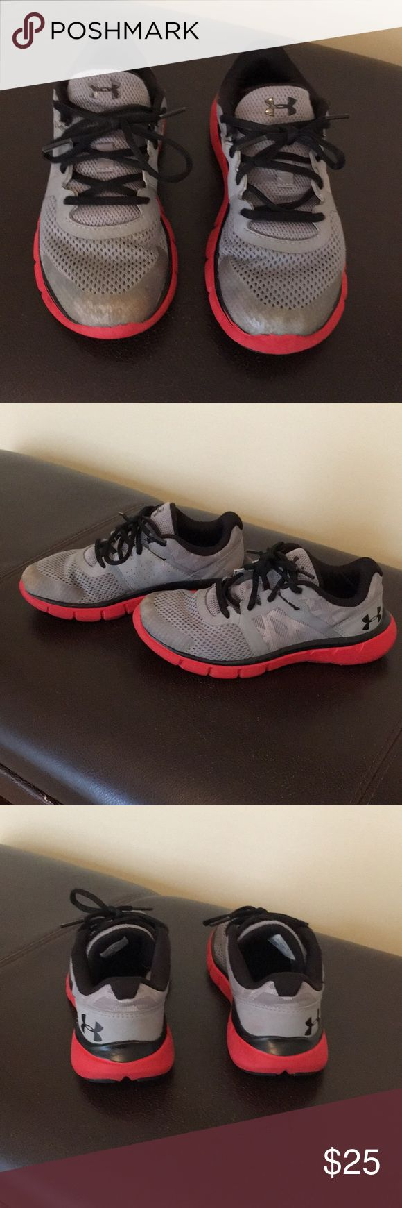 Kids Under Armour tennis shoes Kids Under Armour tennis shoes, size 2 youth, color is gray and with red sole, a few scratches on the front, other than that in good condition. Under Armour Shoes Sneakers