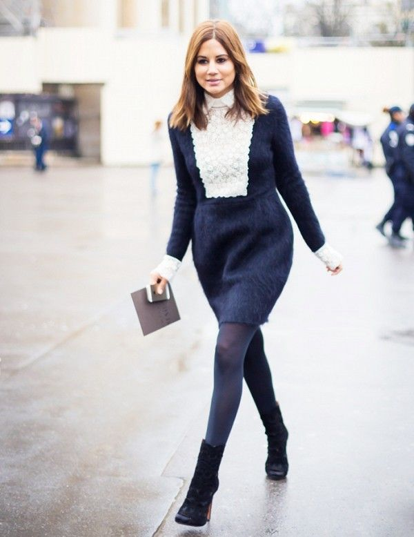 Christine Centenera wears a navy bib dress with black ankle boots:
