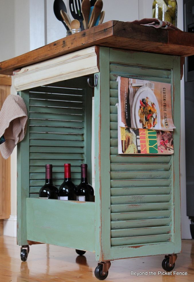Build a rustic island out of shutters, an old drawer & reclaimed wood.