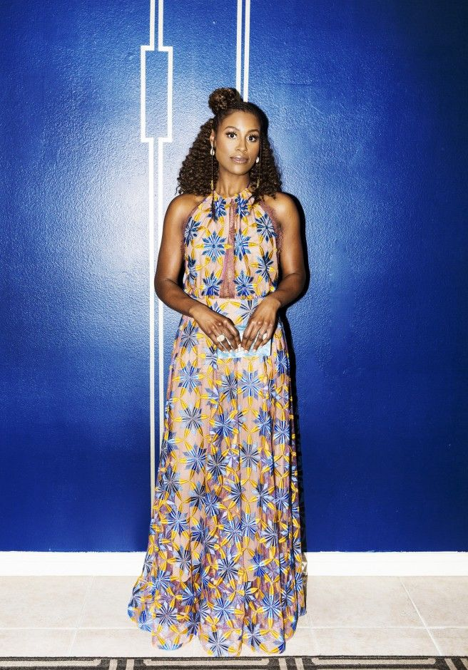 """Issa Rae Getting Ready for the 2017 NAACP Image Awards: While Rae slipped into her Stella Nolasco gown and got final glam touchups by makeup artist Joanna Simkin (who used all natural brand Burts Bees to achieve Rae's glow) and hair stylist Felicia Leatherwood, we listened to Sampha, Big Sean, Solange, Drake in what she would call her """"Sophistiratch Sounds"""" playlist.   Coveteur.com"""