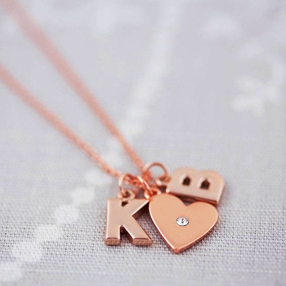 This is a great personalised charm necklace. A cool rose gold charm necklace made with a lovely heart charm and two chunky letter charms. The