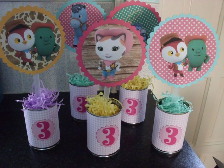 Table decorations using tin cans, drinking straws, oasis, shredded coloured tissue paper and printable Sheriff Callie pictures.