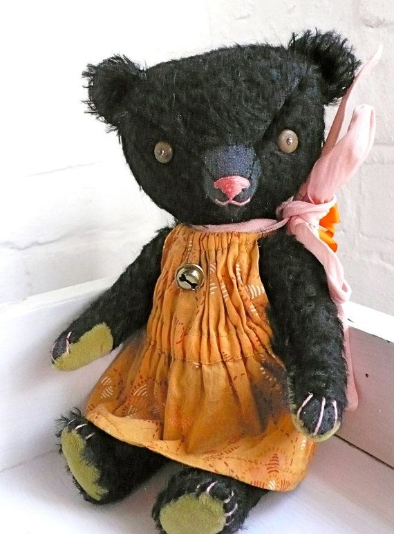 Black teddy bear.