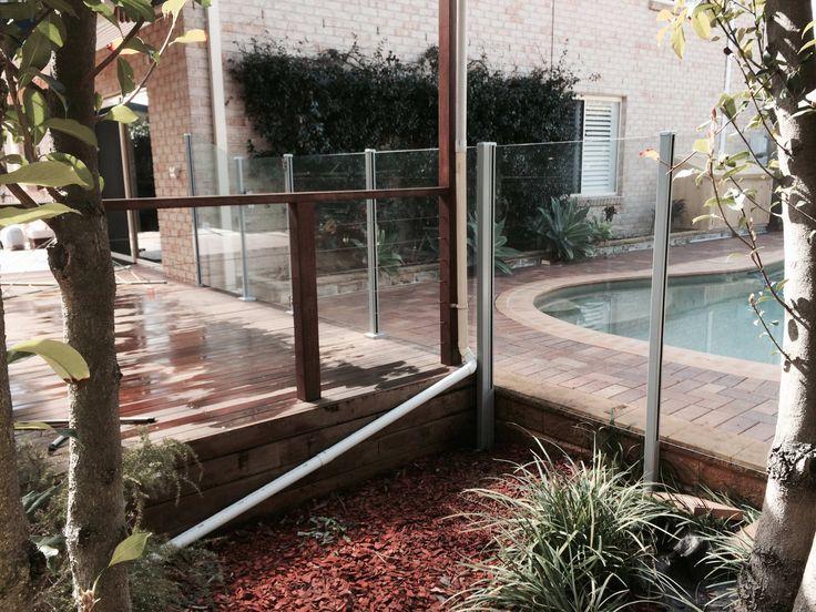 Semi frameless glass pool fence on a deck