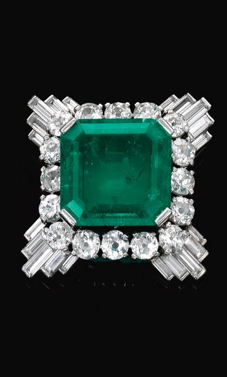 Emerald and Diamond Clip, mounted by Cartier 1930's. The octagonal step-cut emerald, framed by circular-cut and baguette diamonds, engraved Monture Cartier and numbered, French assay and makers marks