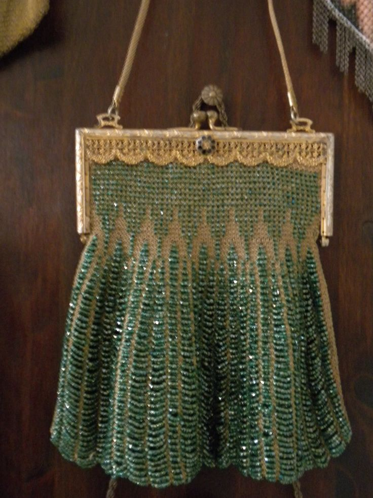 Green glass-beaded, swag-style flapper purse, gold filigree frame with rosette.