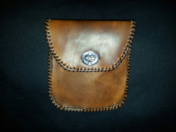 "Handmade genuine leather pouch. This is about 7"" x 5"". There is an inside slot for your card. The closure is sturdy. It can be dyed in a colour of your chose."