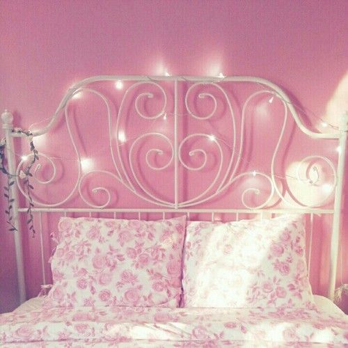 Pretty pink bedroom! Love the idea of stringing lights on the headboard.
