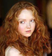 redhead with light eyebrows and innocent makeup