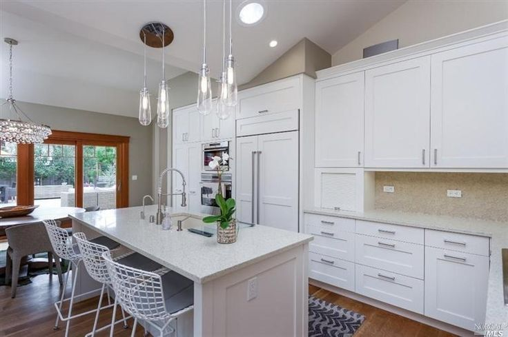contemporary kitchen with pental sparkling white quartz  robert abbey bling large chandelier
