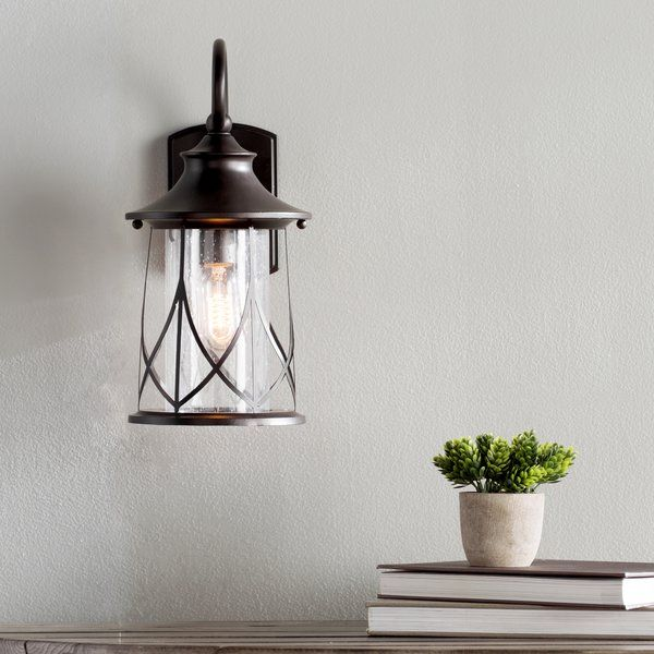 This transitional 1 light outdoor wall light will compliment many outdoor decors. The clear beveled glass adds interest to the look and the open bottom makes changing bulbs easy.
