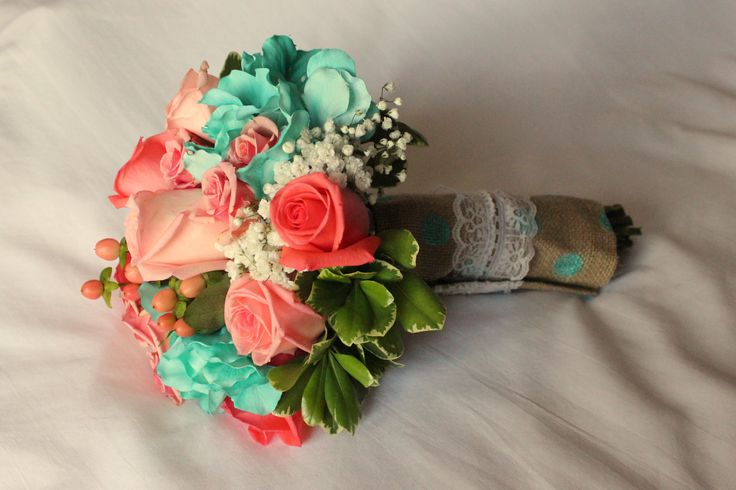 "bridesmaid bouquet for Tiffany blue (turquoise, aqua) wedding: coral ""Engagement"" and ""movie Star"" roses, ""Ilse"" spray roses, jade hydrangeas, peach hypericum berries, ""Overtime"" gyp (baby's breath) and variegated pittisporum wrapped with hand-made burlap and lace wrap"