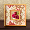 Romantic Flowers  Give a discount frame a makeover by accenting its features with pretty paper. Make a template using scrap paper, trace the template on floral-pattern paper, cut out, and attach using spray adhesive. Glue strips of red paper over the floral-paper edges.