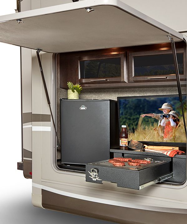 The Industry S Best Outdoor Kitchen With Refrigerator Overhead