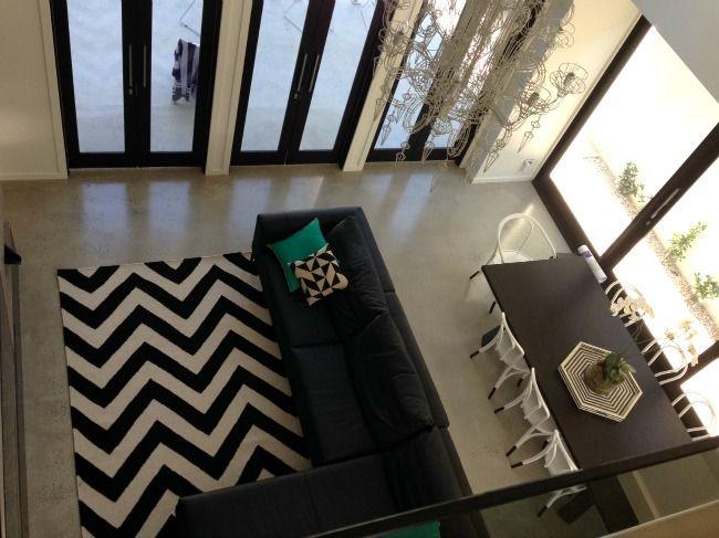 Rebecca Judd's house / Birdseye view of living room and Fenton + Fenton chandelier. Love that chevron rug too !