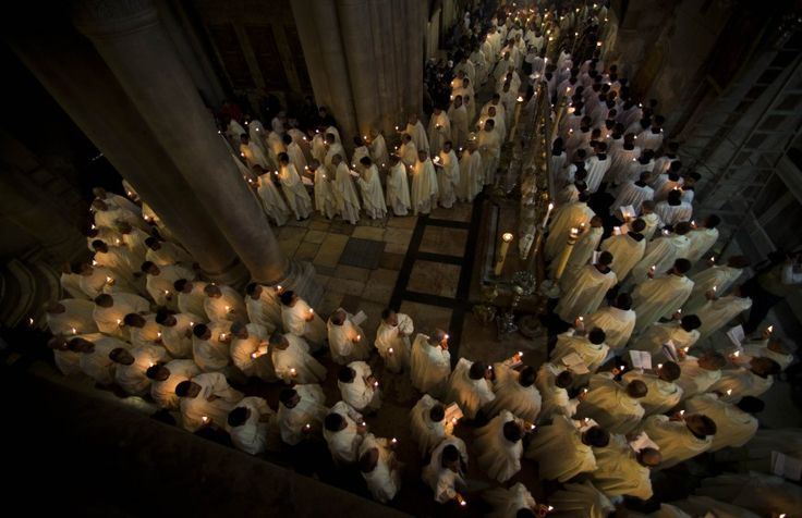 Catholic clergy walk holding candles during the Holy Thursday procession of the Washing of the Feet inside the Church of the Holy Sepulchre, traditionally believed to be the burial site of Jesus Christ, in Jerusalem's Old City. (AP)