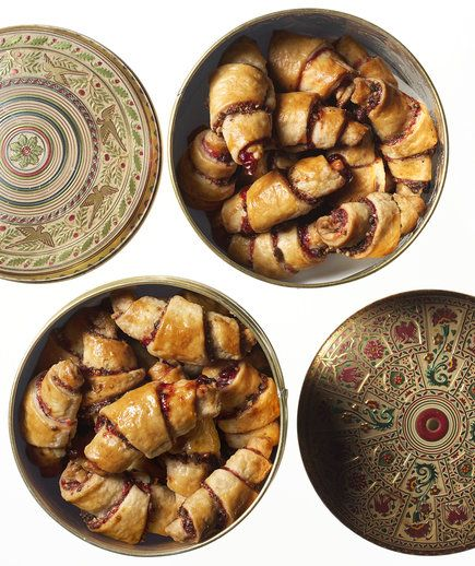Chocolate, Raspberry, and Almond Rugelach | Rugelach are usually made with either a chocolate, fruit, or nut filling. But we would never make you choose just one. Instead, we wrapped them all up in one sweet filling, so you'll never have to pick a favorite. We cook the jam until it's slightly reduced so it stays in place inside the dough while the cookies bake, and doesn't end up all over your baking sheet. It's one of those smart tricks we like to use to make your life easier. A simple egg…