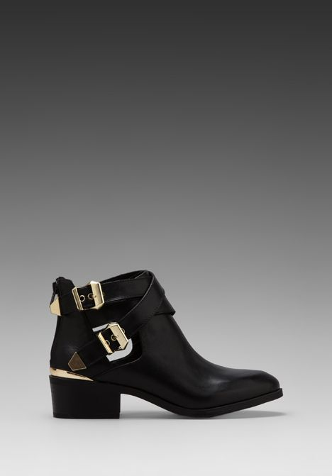 Black ankle boot with gold detail. Classy looks for Fall Fashion. At Revolve Clothing from Seychelles