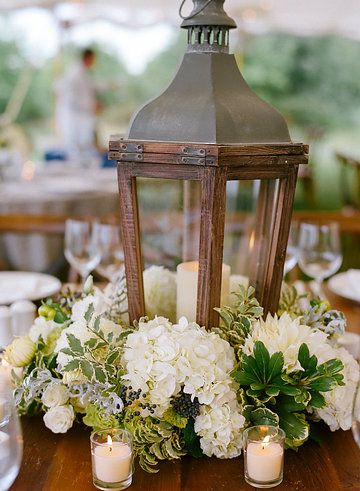 Lanterns in a lush bank of flowers for a romantic, nautical stule wedding. Planning and Design by Pineapple Productions. Floral Design by Dragonfly Events. Photo from Susan and Nic collection by Kate Headley
