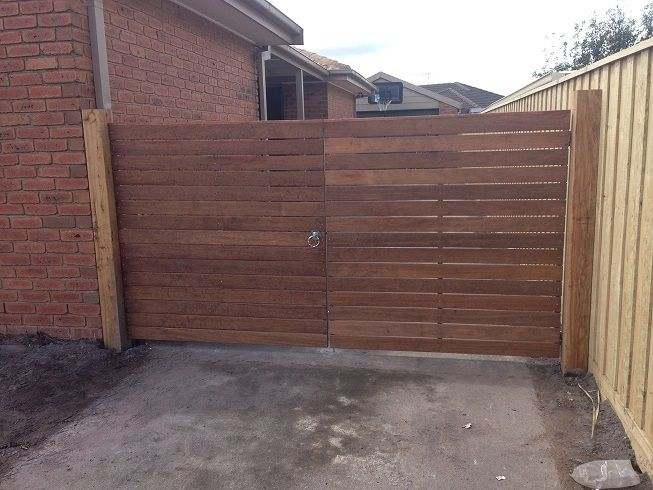 Horizontal merbau double driveway steel frame gate with ringlatch, drop bolts and padbolt
