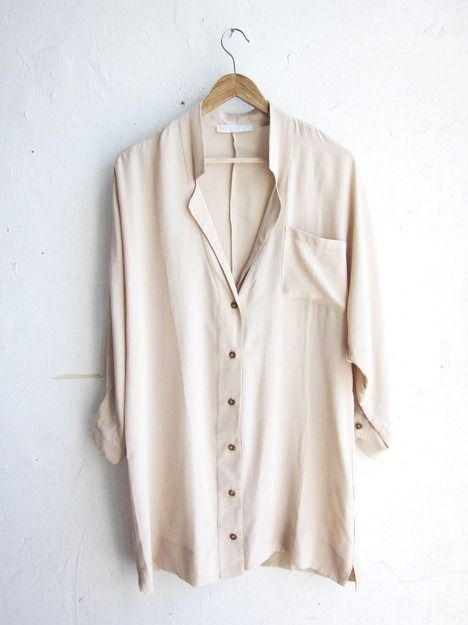long drapey blouse in a loose material that's good with skinny jeans and neutral color that lets jewelry stand out