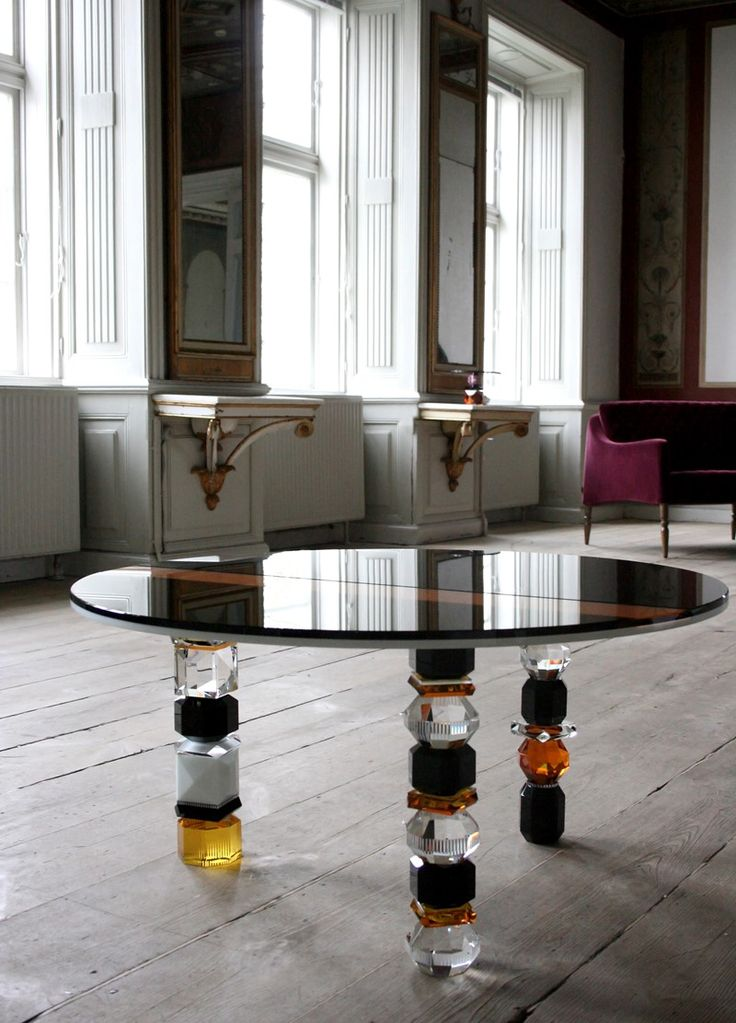 LOUISIANA TABLE A versatile table for the living room. Playfully and unique designed with pure geometric forms and three legs, the Louisiana table fits right in whether placed next to the couch or lounge chair - use in pairs or clusters as a solo piece. The Reflections Copenhagen Louisiana table is intended as a product in the spirit of the iconic. Material: Crystal & Glass