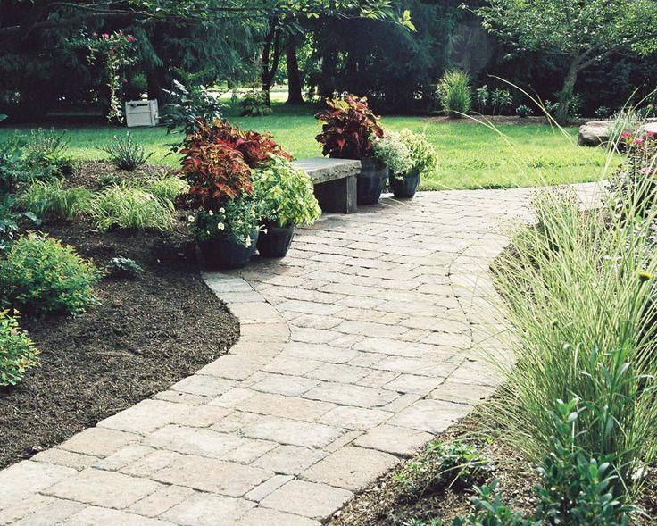 Rustic red flowers paver walkway backyard landscaping for Rustic backyard landscaping ideas