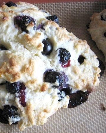 Blueberry Scones ::       2 cups all-purpose flour     3 tablespoons sugar, plus more for sprinkling tops     1 tablespoon baking powder     3/4 teaspoon salt     6 tablespoons cold unsalted butter, cut into pieces     1 1/2 cups fresh blueberries, picked over and rinsed     1 teaspoon grated lemon zest     1/3 cup heavy cream, plus more for brushing tops     2 large eggs, lightly beaten