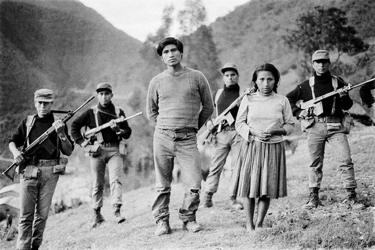 In Lar Mar, Ayacucho, in June 1985, soldiers stood with Ramon Laura Yauly and his wife, Concepcion Lahuana, who said they had been forced to join Shining Path against their will. Photograph appeared in Caretas magazine. Photo credit: © Peru's Truth and Reconciliation Commission