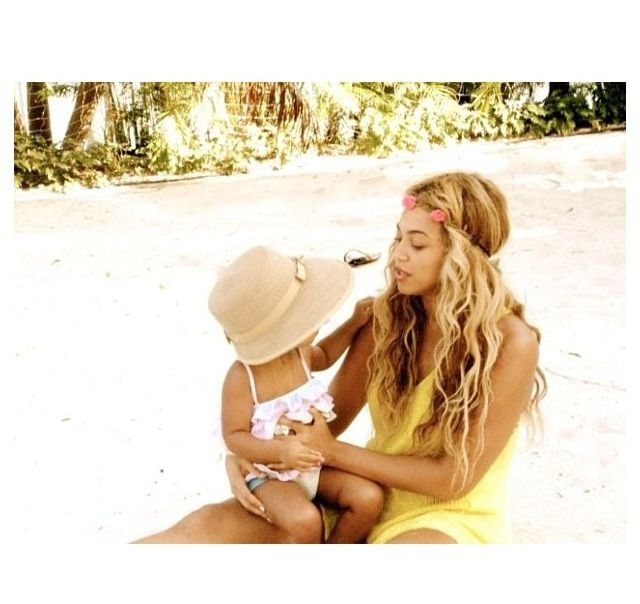 beyonce...great pic of her w her lil luv Check out the website to see more