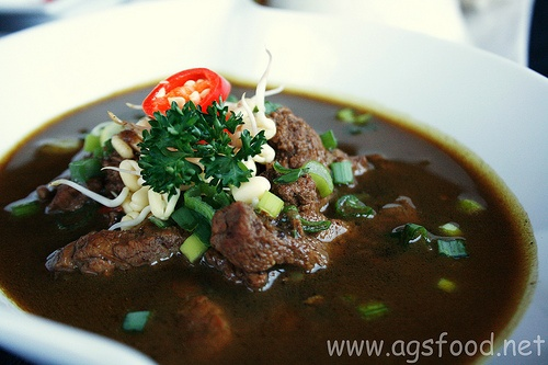 Rawon, a strong rich tasting traditional Indonesian beef black soup from Surabaya, Indonesia.