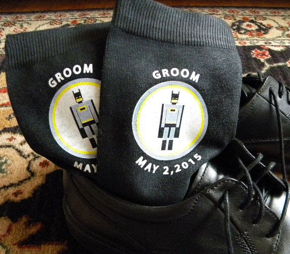 Super Hero Wedding Socks - Groom and Groomsmen Socks. Super heroes are a popular wedding theme and we have created some fun designs that work perfectly for the groom and his super wedding party. Each pair of socks is custom printed with the date and super hero design as well as the role in the wedding. Discover the entire collection of Super Heroes.