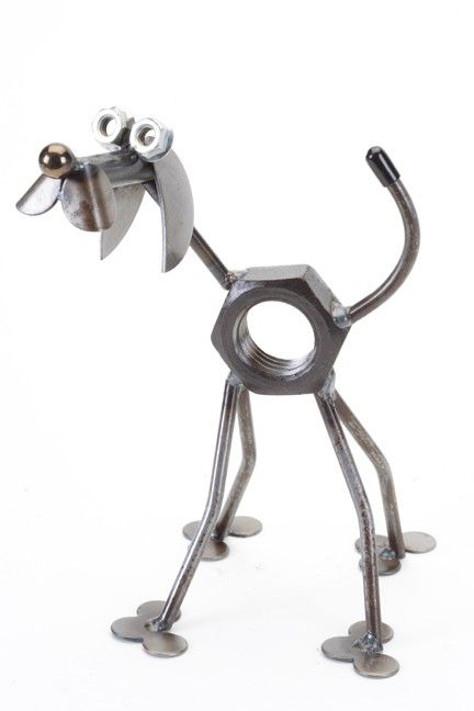 Dog sculpture made out of a large nut. What a fun and whimsical sculpture. Would make a great gift for any dog lover. A great piece for the office