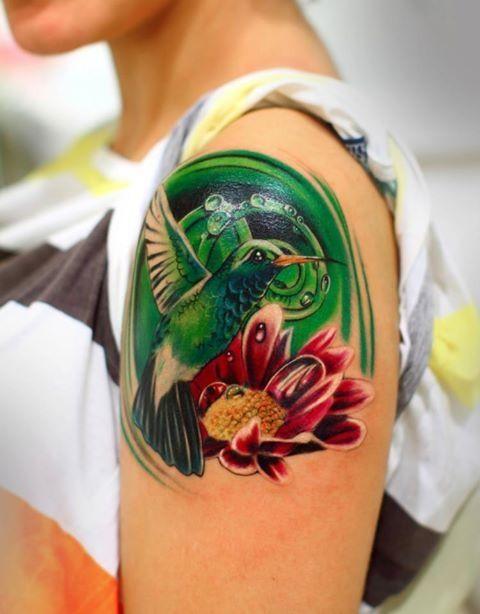 Colour humingbird tattoo by Silvano Fiato