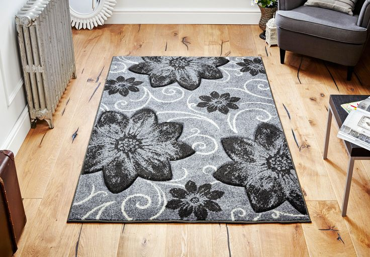 Uplift your decor with this impressive Viva Floral Rug_ Stylish & Trendy with Larger than life floral pattern. #greyrugs #floralrugs #largerugs #designerrugs