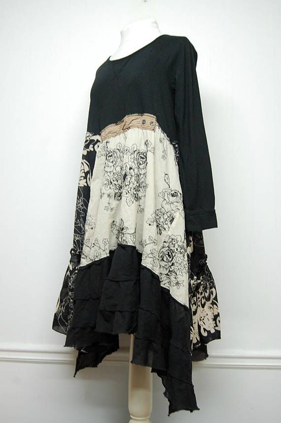 Light weight Cotton fabrics of black and cream flow from a black tee to create this boho chic Mori Girl style dress. The skirt is lined. Womans size Large Approximate Measurements: Bust- to 41 Length from shoulder to hem- varies 38 to 45 Care: Machine wash. Tumble dry low All