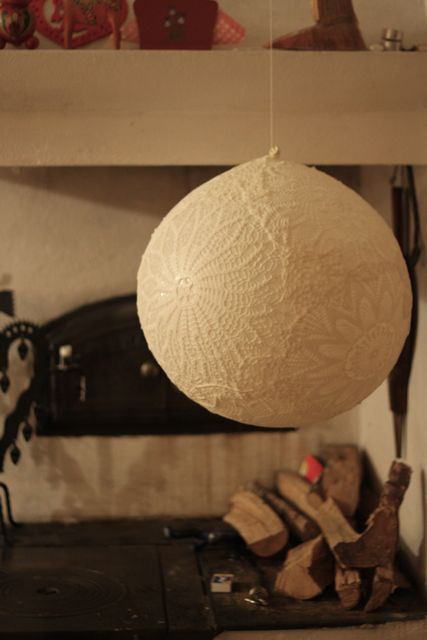 Lace lampshade from doilies, balloons, and glue.  From a Swedish blog, written in English, at http://dosfamily.com/2011/01/lace-lamp/#.  Great instructions; from a country with extreme cold and no mold and may have to be adapted for people who live in the opposite circs.
