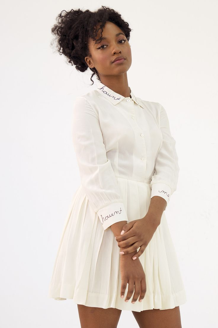 More sizes coming soon, follow us on instagram to stay in the loop! 100% silk dress in creme with light cotton lining, pockets and navy hand embroidered text on collar and cuffs. This garment was ethi