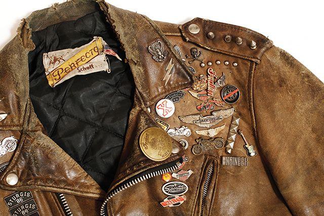 """This jacket is an example of the pride motorcycle riders have for their Schott Perfectos. Even after many long years of loving wear, the owner made sure to keep its tattered Perfecto tag intact."""