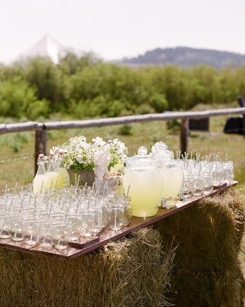 Rustic wedding lemonade station...hay bales for stand, wooden door as table, mason jars as glasses....planner: kendra hobson with simply grand weddings & events